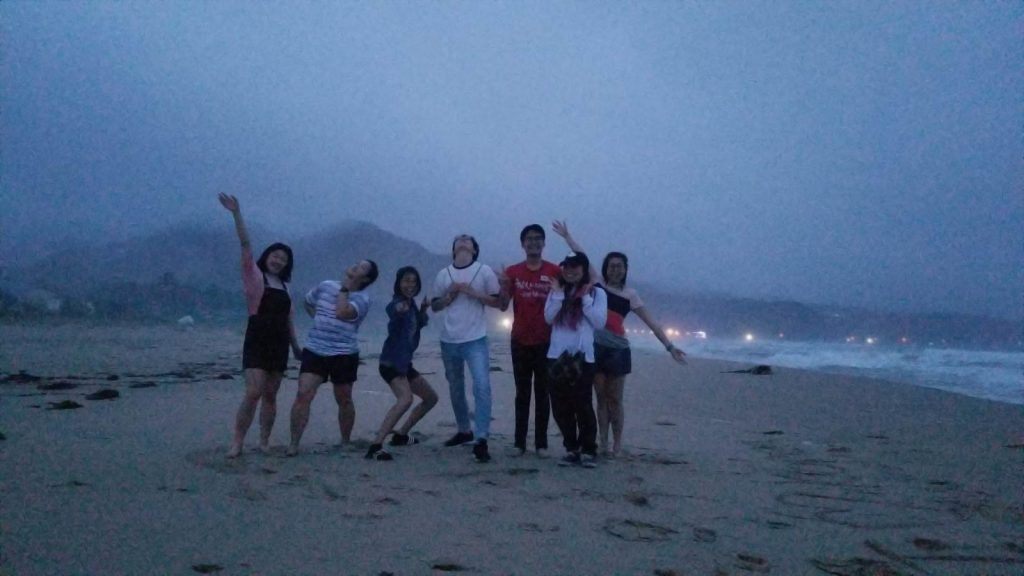 Olivia and friends on the beach in Korea